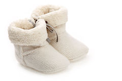 Pair of baby booties over white Royalty Free Stock Images