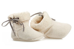 Pair of baby booties over white Stock Photo