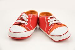 Pair of baby sneakers. On white background stock photography