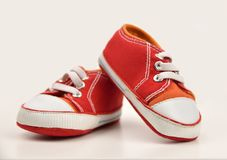 Pair of baby sneakers. On white background stock photos