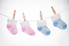 Pair Of Baby Sock Hanging On Rope Royalty Free Stock Images