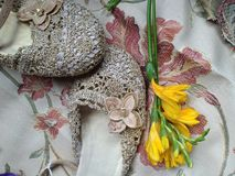 A Pair of Ball Shoes. With a yellow flower on Embroidered fabric Stock Photo