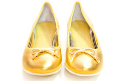 Pair of ballet flats in golden colour. Royalty Free Stock Photo