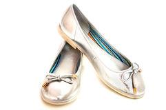 Pair of ballet flats silver glance on white. Ballet flats silver glance on white Royalty Free Stock Photography