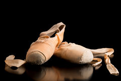 Pair of ballet shoes on a dark background Stock Image