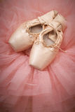 Pair of ballet shoes pointes on wooden floor Stock Photography