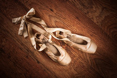 Pair of ballet shoes on a wooden floor Royalty Free Stock Photography