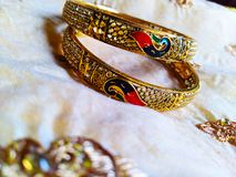 Pair of Bangles which is an Indian traditional jewelry. Picture of Pair of Bangles which is an Indian traditional jewelry made up of pure gold royalty free stock image