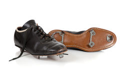 Pair of baseball cleats on white Stock Photos