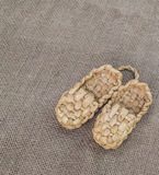 A pair of bast shoes. On a canvas background Royalty Free Stock Image