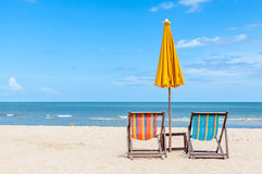 Pair of beach chair with sun umbrella on beautiful beach. Stock Photography