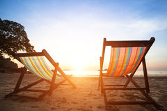 Pair of beach loungers on the deserted coast sea, perfect vacation concept. Stock Images