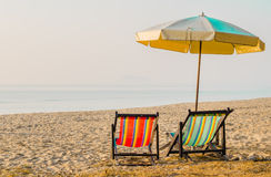 Pair of beach loungers on the deserted coast Royalty Free Stock Image
