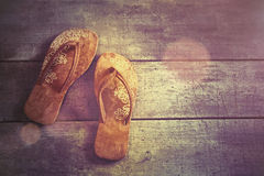 Pair of beach sandals on wood Stock Photo