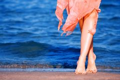 Pair of beautiful feet dancing on a beach Stock Photography