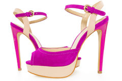 Pair of beautiful pink and beige high hilled shoes, on white Royalty Free Stock Image