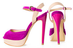 Pair of beautiful pink and beige high hilled shoes, on white Stock Photos