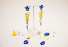 Pair of Beautiful silver  Earrings with gemstones on the natural background Stock Photo