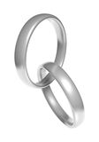 Pair of beautiful silver wedding ring bands linked together Royalty Free Stock Photos