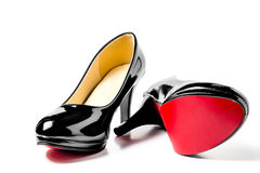 A pair of beautiful women's shoes. Patent leather with heels Royalty Free Stock Image