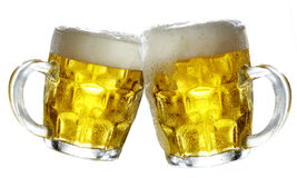 Pair of beer glasses making a toast. Studio photo shoot over  background Royalty Free Stock Photo