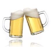 Pair of beer glasses making a toast. Beer splash Stock Photo