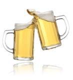 Pair of beer glasses making a toast. Beer splash Royalty Free Stock Image