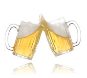 Pair of beer glasses making a toast. Beer splash Stock Images