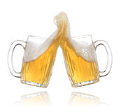 Pair of beer glasses making a toast Stock Photography