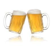 Pair of beer glasses making a toast. Beer splash Royalty Free Stock Images
