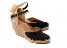 Pair of beige with black suede summer shoes Royalty Free Stock Photos