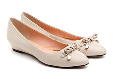Pair of beige female shoes. Over white background stock photo
