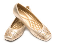 Pair of beige female shoes Stock Photos