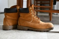 A pair of beige leather boots. royalty free stock photos