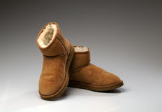 Pair of beige uggs with light fur Royalty Free Stock Image