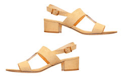 The pair of beige woman sandals.Isolated. Stock Photography