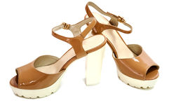 Pair of beige womens high heeled shoes on white background. Royalty Free Stock Photos