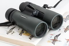 Pair of binoculars on a book