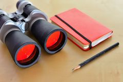 Birding essentials. A pair of binoculars, a journal, and a pencil. These are a must have items for traveling royalty free stock image