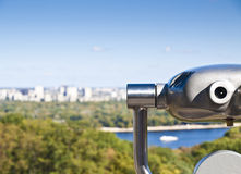 Binoculars overlooking city Royalty Free Stock Images