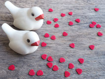 A pair of bird with pieces of heart shape Stock Photo
