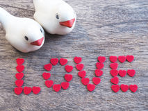 A pair of bird with wording Love on wood Royalty Free Stock Photos
