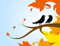 A pair of birds on a branch with the autumn leaves. Silhouettes of two birds in love sitting on a branch with the red and yellow leaves around vector illustration