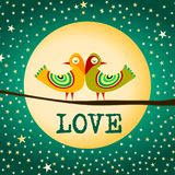 Love Birds Moon and Stars. A pair of birds with stars on the sky and full moon. Love word written below the birds couple Stock Photo