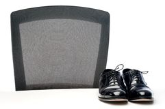 A pair of black business shoes on a white desk Royalty Free Stock Photography