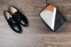Pair of black classic modern shoes with leather bag Royalty Free Stock Photos