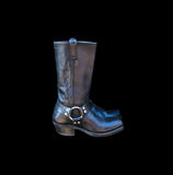 A pair of black cowboy boots isolated on a black background Stock Photos
