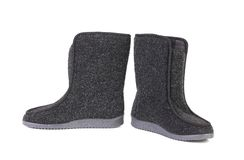 Pair of black felt boots. Stock Photo