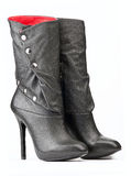 Pair of black female boots with red lining. On the white background royalty free stock image