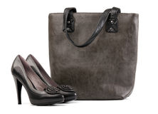 Pair of black female shoes and handbag Stock Photo